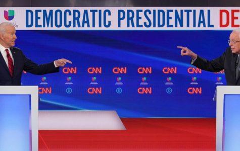 Democratic presidential hopefuls former US vice president Joe Biden (left) and Senator Bernie Sanders point fingers at each other as they take part in the 11th Democratic Party 2020 presidential debate in a CNN Washington Bureau studio in Washington, DC on March 15, 2020.