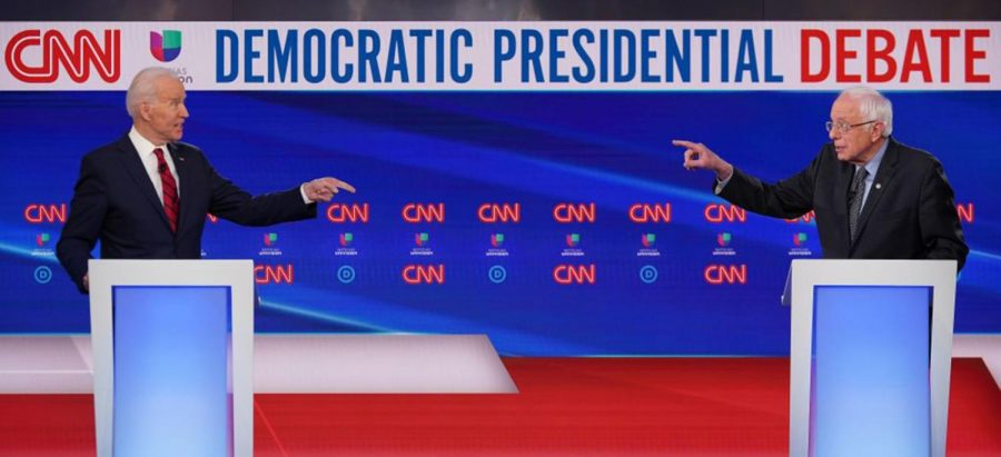 Democratic presidential hopefuls former US vice president Joe Biden (left) and Senator Bernie Sanders point fingers at each other as they take part in the 11th Democratic Party 2020 presidential debate in a CNN Washington Bureau studio in Washington, DC on March 15, 2020.