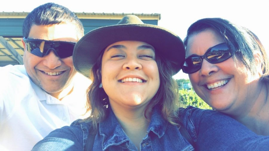Writer Alejandra Rodriguez-Aguero (center) with her father, Gerardo Rodriguez, and mother, Alma Aguero, at a pumpkin patch.