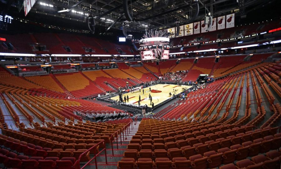 A view of the empty AmericanAirlines Arena before the start of an NBA basketball regular season game between the Miami Heat and the Charlotte Hornets on Wednesday, March 11, 2020 in Miami. The Golden State Warriors announced Wednesday they will play games without fans in their San Francisco arena because of the coronavirus.