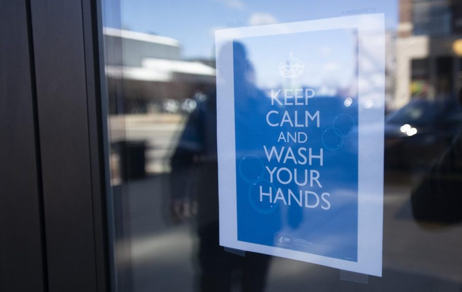A sign on the front door of Jackson City Hall encourages hand washing on Friday, March 13, 2020.