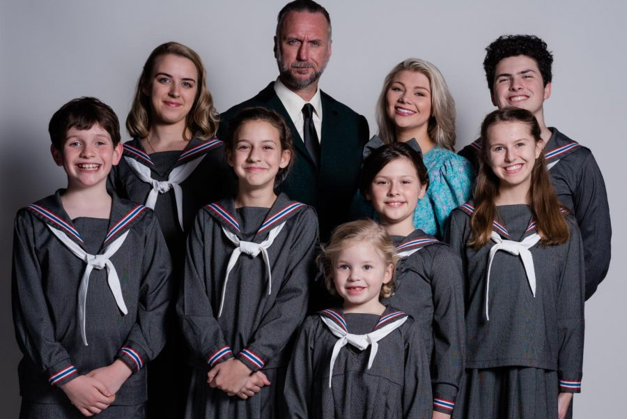 "Maria and the Von Trapp family. (l-r, b-f)  Liesl (Jordan Davis), Captain Von Trapp (Zach Hanner), Maria (Elizabeth Stovall), Friedrich (Jakob Gruntfest), Kurt (Salder Selby), Louisa (Baylee Allen), Brigitta (Braelyn Sudduth), Marta (Piper Holmes), Gretl (Katie Grace Marinos) pose in for a photo in preparation for their performance of ""The Sound of Music"" at Thalian Hall. Photo by Opera House Theatre Company."