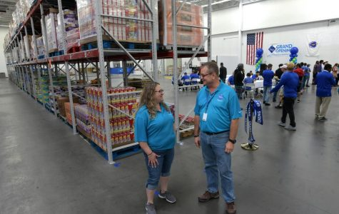 Assistant general manager Kathy Hartman, left, and general manager Bob King chat in the warehouse where Sam's Club orders will be filled. The Sam's Club fulfillment center held a ribbon-cutting ceremony Thursday on Tobias Boland Way. [T&G Staff/Christine Peterson]