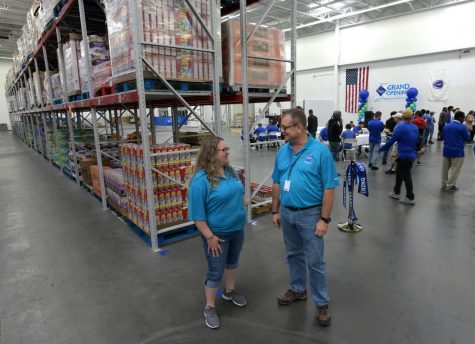 Assistant general manager Kathy Hartman, left, and general manager Bob King chat in the warehouse where Sam