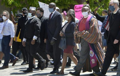 Community leaders and clergy members march north on State Street on June 6, 2020, in Erie. More than 2,000 people marched from 11th and State streets to Perry Square to protest the killing of George Floyd on Memorial Day in Minneapolis. ([GREG WOHLFORD/ERIE TIMES-NEWS)