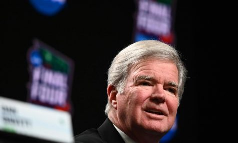 NCAA President Mark Emmert talks during a news conference before the men