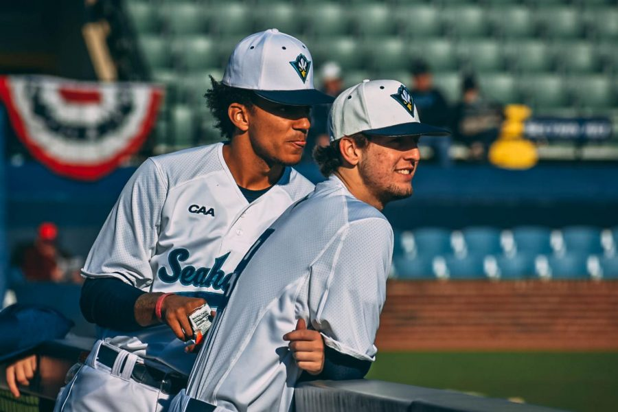 Kohl Abrams & Riley Davis in the dugout watching warmups before a game.