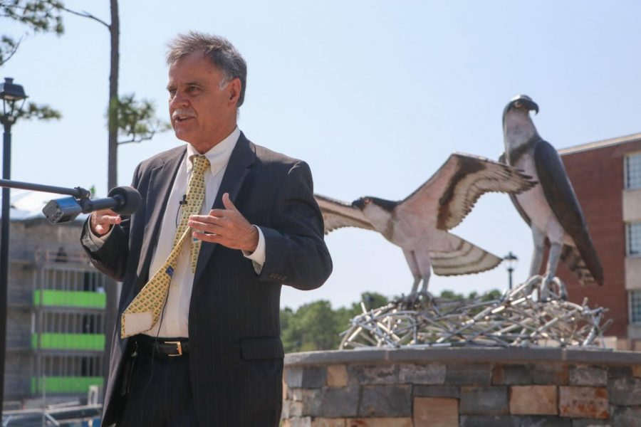 UNCWs Chancellor Jose V. Sartarelli in front of the new sculpture.