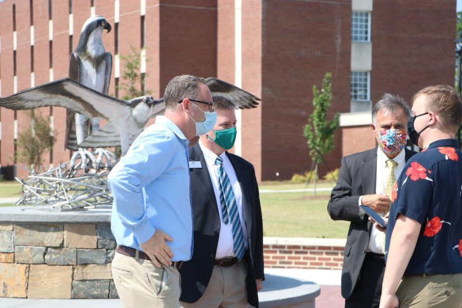 BLAH and UNCW Chancellor Jose V. Sartarelli in front of the new sculpture.