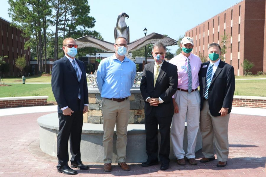 Associate Vice Chancellor for Business Affairs-Facilities Mark Morgan; Director of Housing and Residence Life Peter Groenendyk; Chancellor Jose V. Sartarelli;  Associate Vice Chancellor and Dean of Students Mike Walker; Interim Vice Chancellor for Student Affairs Brian Victor in front of the new sculpture.