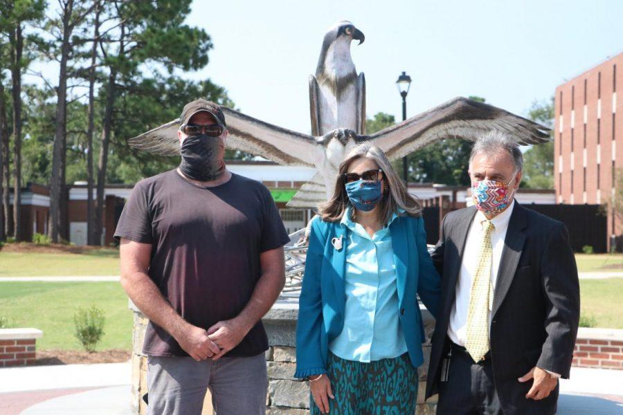 The artist Dumay Gorham; Mrs. Katherine Sartarelli; Chancellor Jose V. Sartarelli in front of the new sculpture.