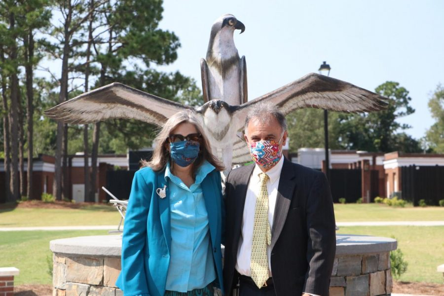 Mrs. Katherine Sartarelli and UNCW Chancellor Jose V. Sartarelli in front of the new sculpture.