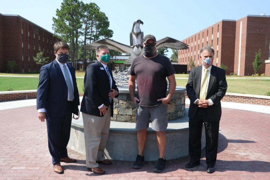 Vice Chancellor for University Advancement Eddie Stuart;  Interim Vice Chancellor for Student Affairs Brian Victor; the artist Dumay Gorham; Chancellor Jose V. Sartarelli in front of the new sculpture.