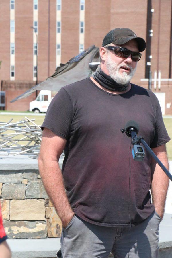 Sculpture artist Dumay Gorham answering press questions.
