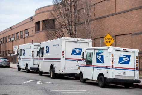 USPS trucks parked on Cambridge Avenue behind the Central Avenue post office and behind the Christa McAuliffe School PS 28 in the Heights section of Jersey City, Monday, Jan. 27, 2020