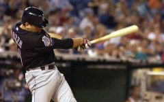 Mike Piazza swinging at a pitch in a game for the New York Mets (Photo by Gerald S. Williams)