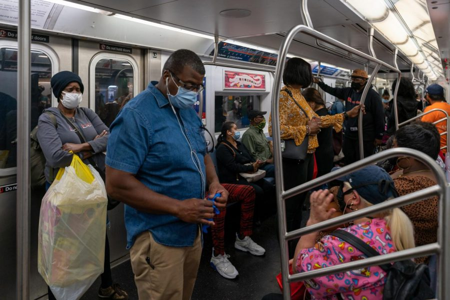 People ride the subway on the first day after reopening following the coronavirus lockdown, on June 8, 2020, in New York. (David Dee Delgado/Getty Images/TNS)