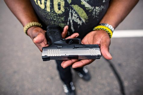 MINNEAPOLIS, MN - JULY 25: Reverend Tim Christopher, hold his firearm that he always carries while attending the meet-and-greet event held Minnesota Freedom Fighters on Saturday, July 25, 2020 in Minneapolis, MN. Christopher has testified before the MN House Judiciary Committee on gun control legislation. (Jason Armond/Los Angeles Times/TNS)