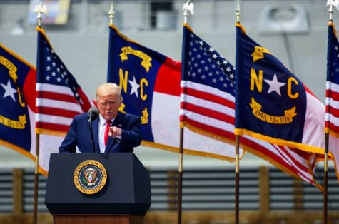 President Donald Trump speaks to a small crowd outside the USS North Carolina on Sept. 2, 2020 in Wilmington, North Carolina. President Donald Trump visited the port city for a brief ceremony designating Wilmington as the nation's first WWII Heritage City. The title is in honor of the area's efforts during WWII.(Photo by Melissa Sue Gerrits/Getty Images/TNS)