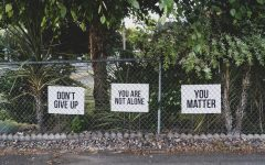 Signs posted on the fence of a 7-11 in Salem, Oregon.