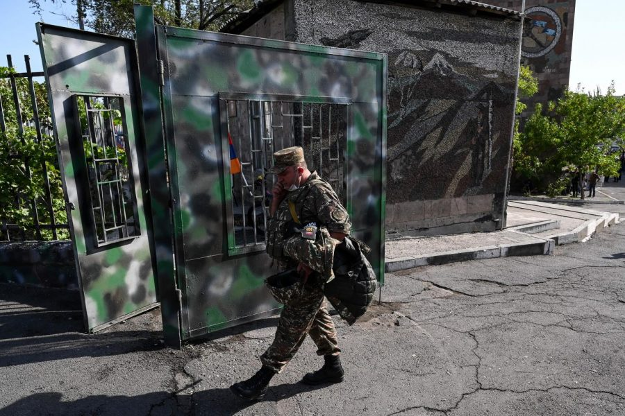A man wearing a military uniform walks in front of a military commissariat in Yerevan on Spet. 30, 2020. Armenian Prime Minister Nikol Pashinyan on Wednesday said peace talks with Azerbaijan under Russian mediation would be inappropriate, as fighting over the breakaway Nagorny Karabakh region entered a fourth day. (AFP/Getty Images/TNS)