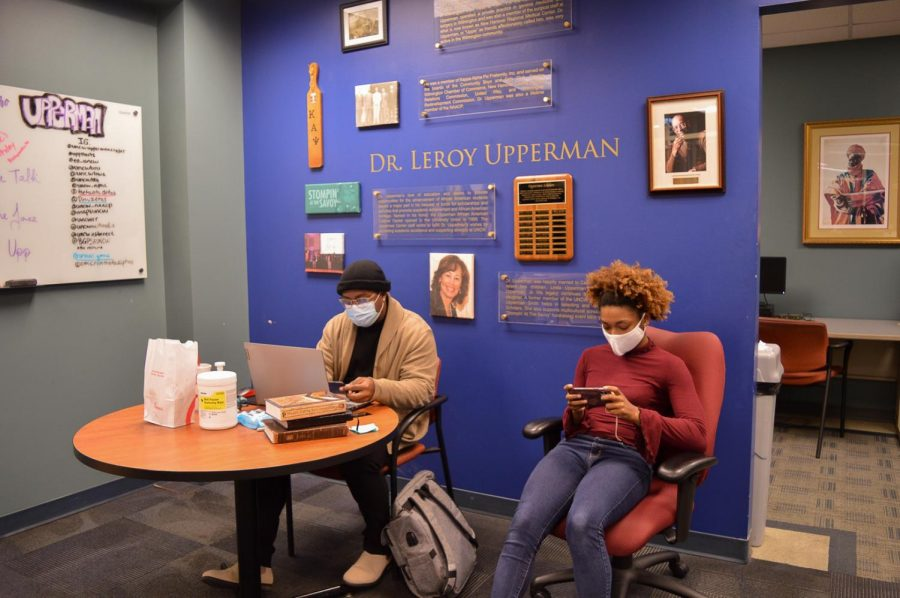 Christopher Neal and Asia Adams sit and work inside the Upperman African American Cultural Center.