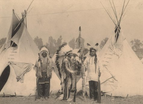 Black Foot, Standing Bear, Big Eagle, Sioux. Three members of the Sioux tribe pose in Indian Village, 1898.