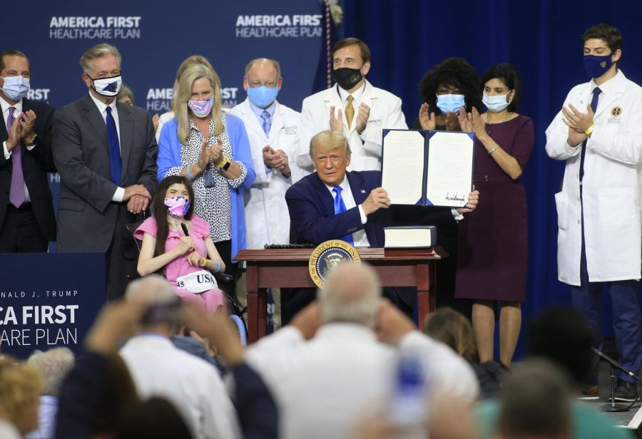 U.S. President Donald Trump reacts after signing an executive order following his remarks on his health care policies on Thursday, September 24, 2020 in Charlotte, North Carolina. Trump's trip to North Carolina marks his fifth time in the state within the last 30 days.