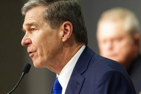 North Carolina Gov. Roy Cooper announces a stay at home order for the entire state starting Monday at 5 p.m. to help slow the spread of coronavirus. Cooper made the announcement during a briefing Friday, March 27, 2020 at the State of North Carolina Emergency Operations Center in Raleigh.