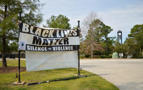 A BLM poster near the UNCW pond.  Photo by Kaylin Damico