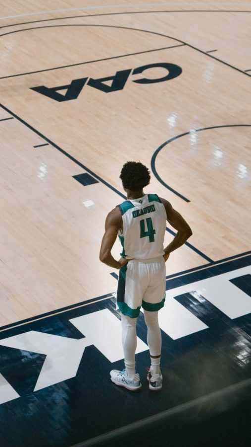 Mike Okauru during UNCW's matchup with Hostra on Jan. 30, 2021