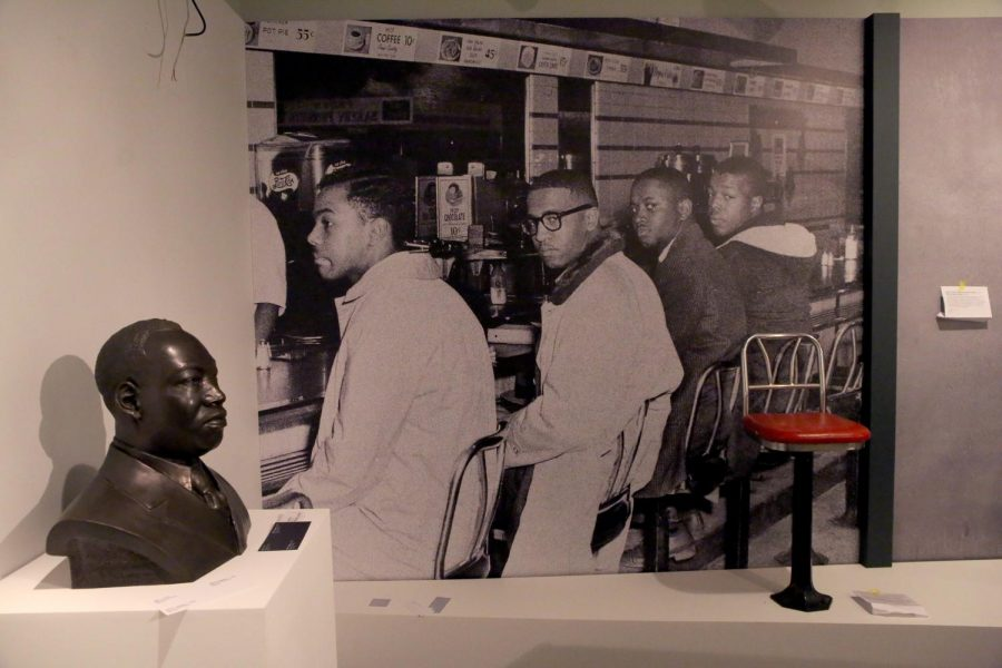 """A photo display of the famous lunch counter sit-in in Greensboro North Carolina. DuSable Museum of African American History museum, on August 26, 2015, prepares a new exhibit, """"Freedom, Resistance and the Journey Toward Equality,"""" at the Chicago museum."""
