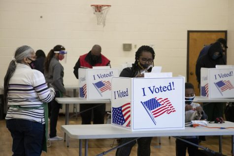 "India Richburg votes with her son Nash Waiters, 4, at the North Springs 2 voting location in Columbia, South Carolina on Tuesday, Nov. 3, 2020. ""In and out in five minutes, tops,"" Richburg said, describing how long it took to vote."