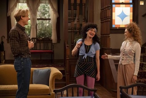 """Whether Agnes (Kathryn Hahn, center) is Agnes Harkness or not, her amazing performance as the generic """"nosy next-door neighbor"""" character is one of the best parts of """"WandaVision."""" And yes, those clothes she, Vision (Paul Bettany, left) and Wanda (Elizabeth Olsen, right) have on are what people wore in the 1980s."""