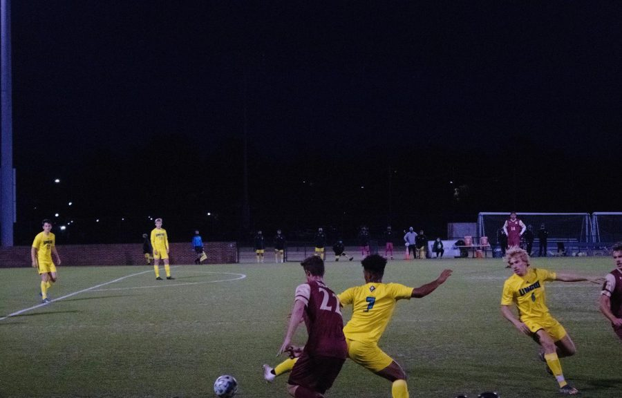 The UNCW men's soccer team fights for the ball.