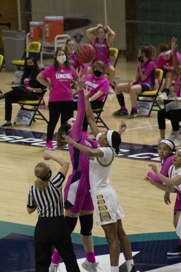 UNCW's women's basketball team fights for the ball.