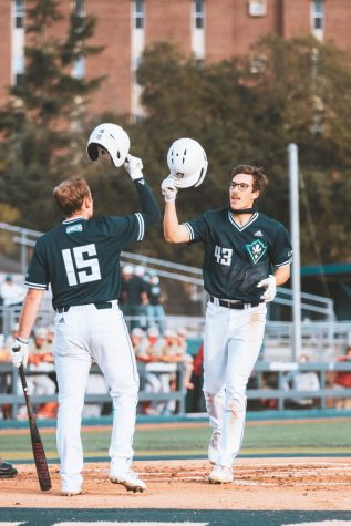 Kip Brandenburg crossing home plate after hitting a home run in UNCW
