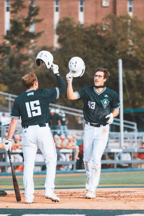 Kip Brandenburg crossing home plate after hitting a home run in UNCW's matchup with NC State on Mar. 23, 2021.