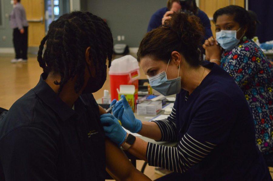 UNCW student, Jacobi Loyd, receives his vaccine.