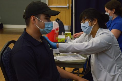 UNCW student, Alfredo Espinal, receives his vaccine.