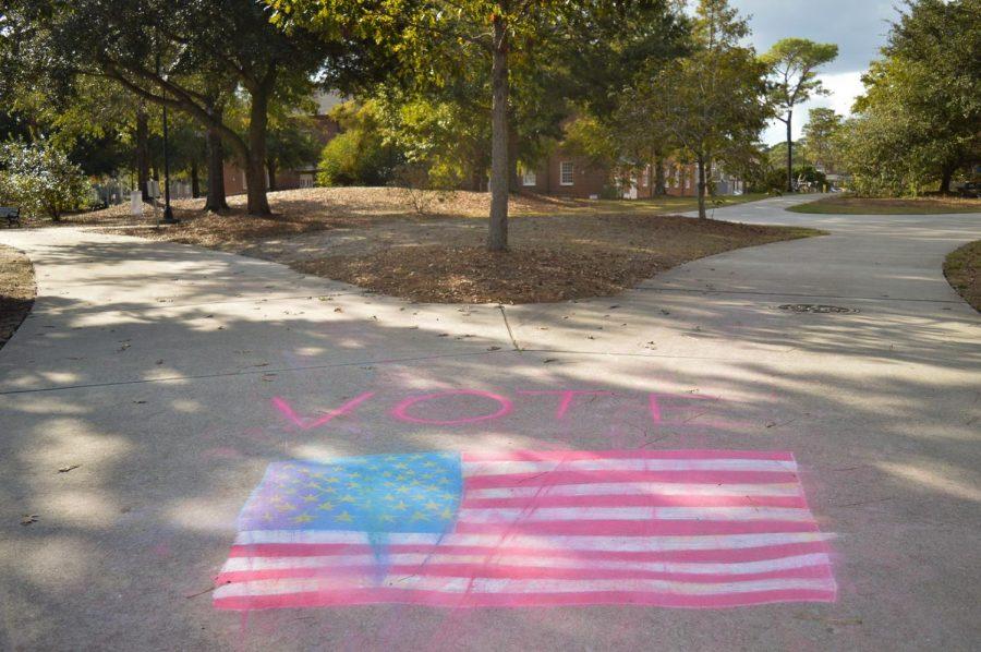 Voting chalk on the sidewalk at UNCW.