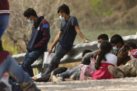 Asylum-seekers who crossed the U.S.-Mexico border illegally wait to be processed in Mission, Texas.