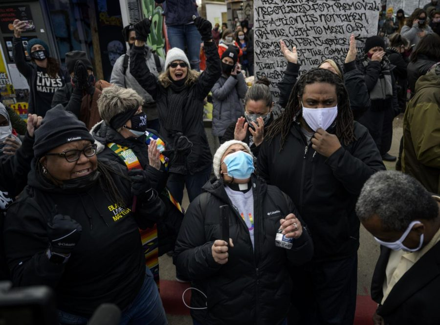 Members of the Multi-faith Anti-Racism Change and Healing Group celebrate at 38th and Chicago after the verdict was read in the murder trial of former Minneapolis police officer Derek Chauvin, Tuesday, April 20, 2021 in Minneapolis.