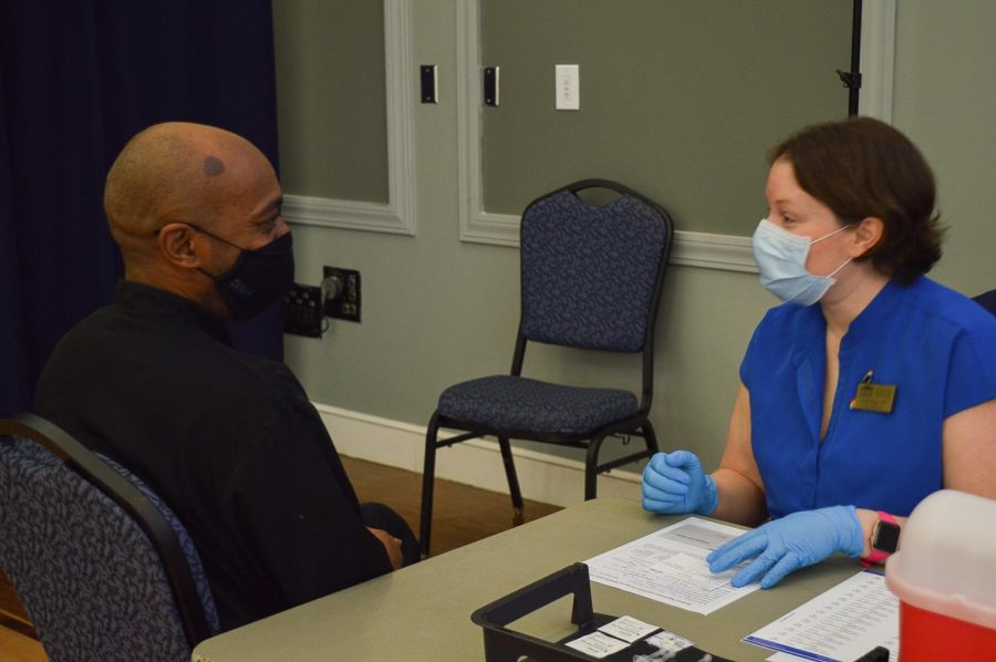 Preparing to administer a vaccine in the Burney Center.