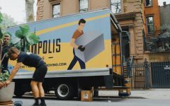 Movers load a truck.