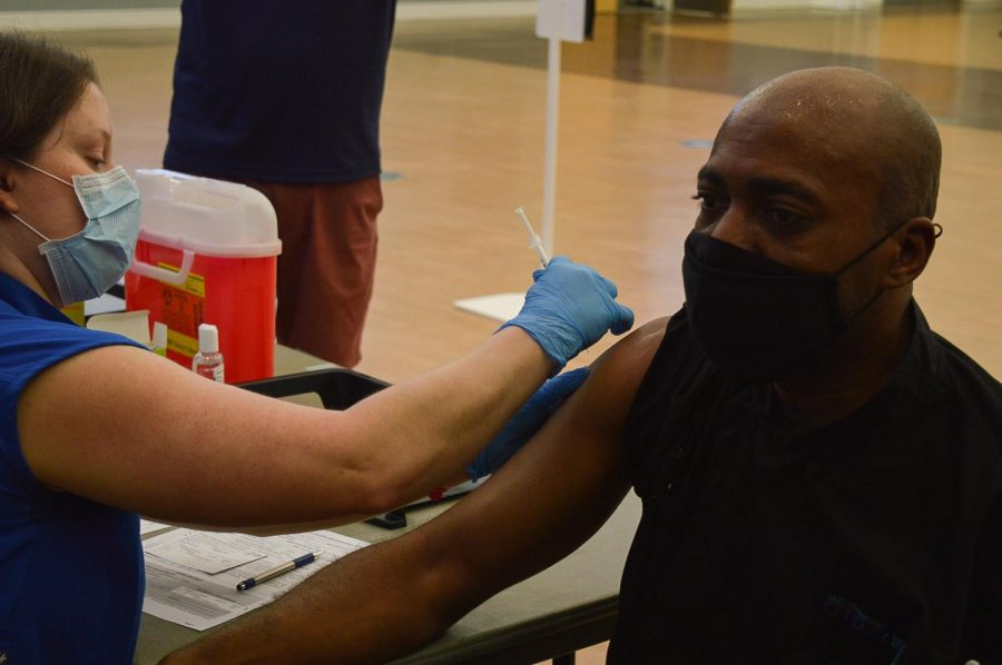 UNCW staff member recieves the Johnson & Johnson vaccine at the Burney Center clinic.