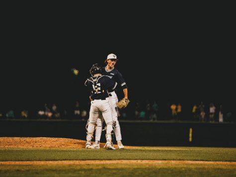 Ethan Chenault and Matt Suggs after UNCWs win over Northeastern on May 28, 2021.