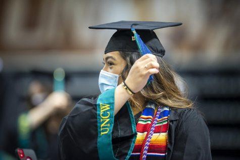 A graduating senior moves her tassel.