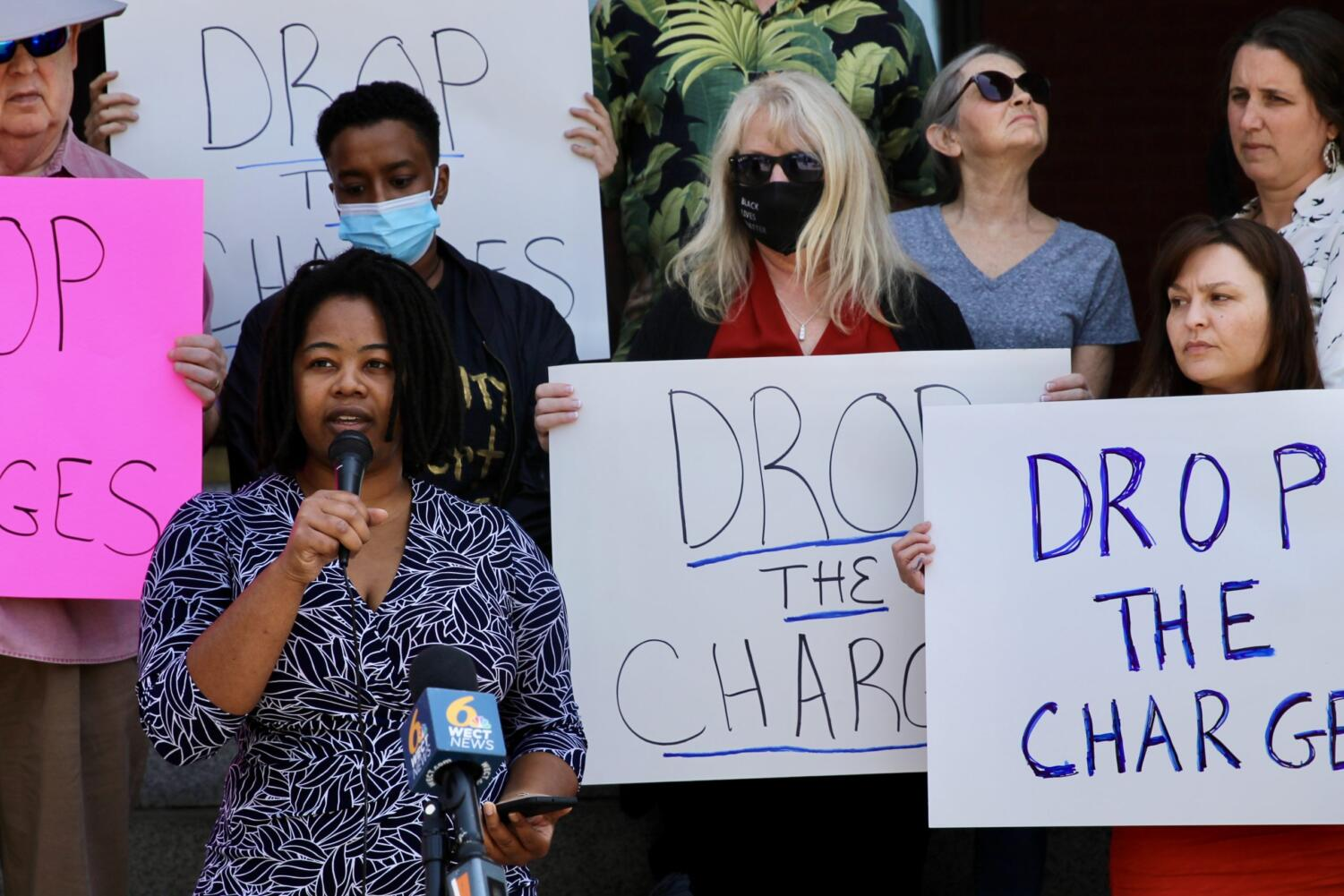 New Hanover for All's Ashley Daniels speaks at a press conference Monday, calling on the district attorney to drop charges against three prominent protesters in Wilmington who are accused of vandalizing property.