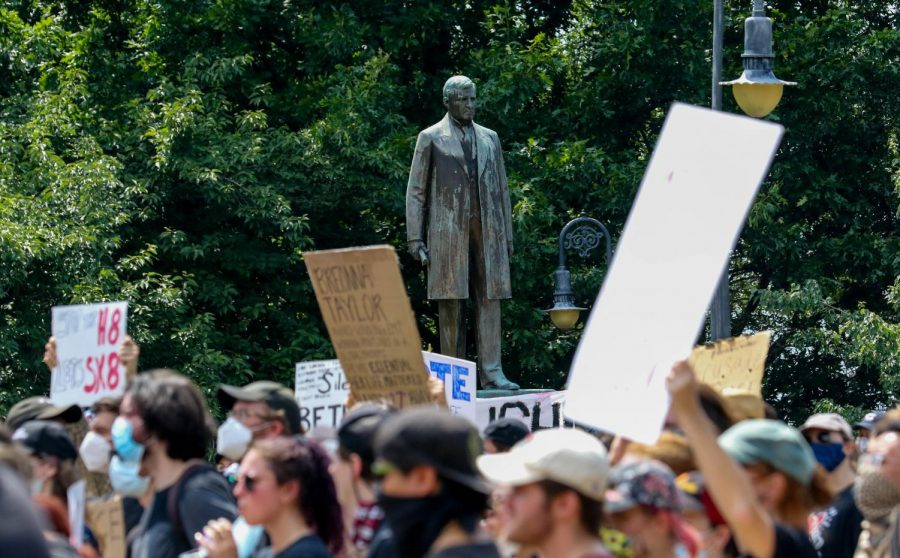 The Emmett Till statue is seen through protesters at the South Carolina State House in Columbia, South Carolina demonstrating their anger over racial injustice on June 5, 2020.